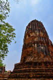 Ruins of stupa and statue of Buddha in Wat Mahathat, the ancient Thai temple in Ayutthaya Historical Park. Stock Photos