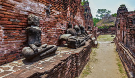Ruins of stupa and statue of Buddha in Wat Mahathat, the ancient Thai temple in Ayutthaya Historical Park. Stock Image