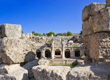 Ruins of temple in Corinth, Greece. Archaeology background Royalty Free Stock Image
