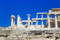 Ruins of temple on island Aegina, Greece. Archaeology background Royalty Free Stock Photos