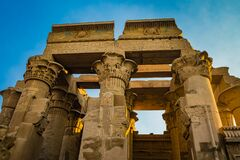 Ruins of the Temple of Kom Ombo in the Nile river at sunset, Egypt at dawn