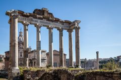 Temple of Saturn. Ruins of Temple of Saturn at Roman Forum with blue sky Royalty Free Stock Photos