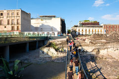 The ruins of the Templo Mayor, a major aztec temple in Mexico City. MEXICO CITY,MEXICO - DECEMBER 28,2016 : Visitors at the ruins of the Templo Mayor, one of the Royalty Free Stock Photos