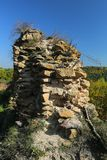 Remains of the broken castle walls. Ruins of the thick medieval castle walls stock photography