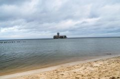 Ruins of torpedownia on Baltic Sea at cloudy day. royalty free stock photography
