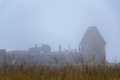 Ruins and tourists in a dense fog royalty free stock photo