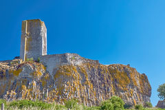 The ruins of the tower of a medieval castle on a rock. In France Stock Image