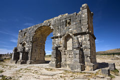 Ruins of the triumphal arch in Volubilis. Morocco. Volubilis. The Triumphal Arch dedicated to the emperor Caracalla. This site is on UNESCO World Heritage List Stock Photos