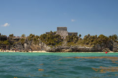 Ruins of Tulum, Quintana Roo, Mexico. Tulum, Mexico - February 25, 2017: view of ruins of archeological Mayan site of Tulum, with beach goers on the shore royalty free stock photography