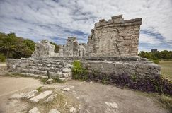 Ruins of Tulum. Side view of the remains of a small Mayan temple in the Tulum complex in Mexico taken at sunset stock image