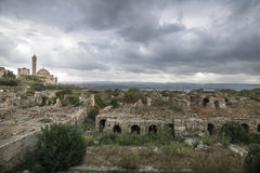 Ruins with view on the mosque with dramatic cloudscape in Tyre, Sour, Lebanon Stock Photo