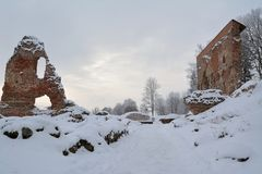 Ruins of the Viljandi Order Castle in winter. Some frosty trees and snow everywhere. Viljandi, Estonia Stock Photo