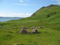 Ruins of village in Scotland. A so-called clearance village in Scotland on a very picturesque spot on Ardnamurchan (west-coast of Scotland royalty free stock photos
