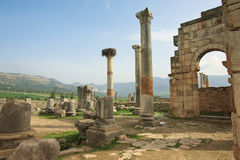 The ruins of Volubilis Capitol. Volubilis is the best preserved Roman site in Morocco, and features some brilliant mosaics. It was declared a UNESCO World Stock Images
