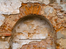 Ruins of a wall destroyed by moisture and precipitation Royalty Free Stock Photography