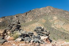 Ruins of a wall in the mountains. Stone remains of a wall crumbling in the mountains Royalty Free Stock Photography