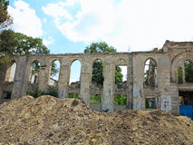 Ruins of walls of medieval castle with vegetation Stock Photography