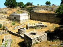 The ruins of the walls of Troy (Truva) Truva. Troy (Truva) it is best known for being the setting of the Trojan War described in the Greek Epic Cycle and Royalty Free Stock Photo