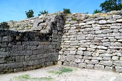 The ruins of the walls of Troy (Truva) Truva. Troy (Truva) it is best known for being the setting of the Trojan War described in the Greek Epic Cycle and Royalty Free Stock Photos