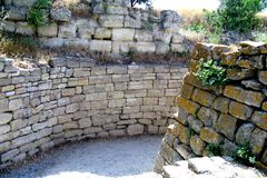 Ruins of walls in Troy (Truva) Truva. Troy (Truva) it is best known for being the setting of the Trojan War described in the Greek Epic Cycle and especially in Royalty Free Stock Photography