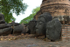 The ruins of Wat Phra Sri Sanpetch Temple in Ayutthaya. The ruins of Buddha statues at Wat Phra Sri Sanpetch Temple in Ayutthaya Stock Photo