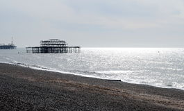 The ruins of the West Pier in the light of the rising sun. Royalty Free Stock Photo