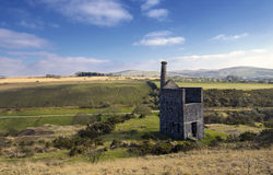 The ruins of Wheal Betsy Engine House in Devon. The ruins of Wheal Betsy Engine House near Mary Tavy in Devon with its leaning chimney Stock Photo