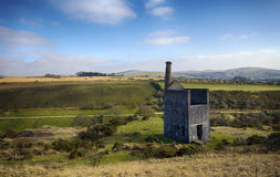 The ruins of Wheal Betsy Engine House in Devon. The ruins of Wheal Betsy Engine House near Mary Tavy in Devon with its leaning chimney Royalty Free Stock Photo