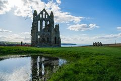 Ruins of Whitby Abbey in North Yorkshire in the UK. It is ruins of the Benedictine abbey. Now it is under protection of the English Heritage Royalty Free Stock Photo