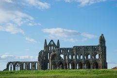 Ruins of Whitby Abbey in North Yorkshire the UK. Ruins of Whitby Abbey in North Yorkshire, the UK. It is ruins of the Benedictine abbey. Now it is under Stock Photography