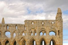 Ancient whitby abbey, yorkshire, uk. The ruins of Whitby Abbey in Yorkshire, famous for providing inspiration for Bram Stoker`s Dracula on a windy overcast day Royalty Free Stock Photo