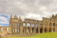 Ancient whitby abbey, yorkshire, uk. The ruins of Whitby Abbey in Yorkshire,  famous for providing inspiration for Bram Stoker`s Dracula, yorkshire, uk Royalty Free Stock Image