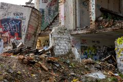 Ruins of white bricks house. Demolition of white bricks building. White bricks house in ruins. Saldus, Latvia stock photo