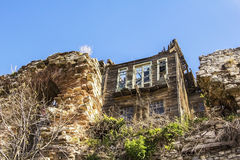The ruins of a wooden house among the remains of the ancient walls of Constantine Stock Image
