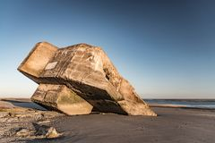 Ruins of a german bunker on the beach at low tide. The ruins of a WWII German bunker seem to be stranded on a beach in the Bay of Somme Royalty Free Stock Photos