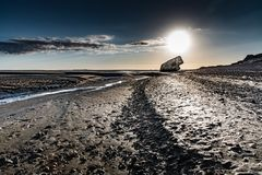 Ruins of a german bunker on the beach at low tide. The ruins of a WWII German bunker seem to be stranded on a beach in the Bay of Somme Stock Photography