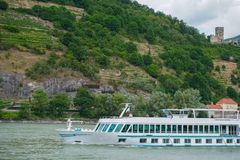 ruise ship on Danube river and mountains in background. royalty free stock photo