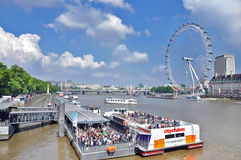 Сruise ships on the river Thames and the London eye. Сruise ships on the river Thames on the background of the Ferris wheel London eye. United Kingdom Stock Photo