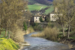 Ruisseau et village Photographie stock