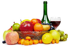 Аruit and wine bottle - still-life Stock Photos