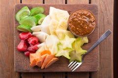 Rujak: Indonesian Fruit Salad (starfruit, water apple, cucumber, mango, pineapple, raw sweet potato, bengkoang / jicama) with swee Royalty Free Stock Photography