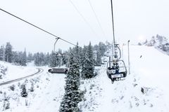 Ruka, Finland - November 24, 2012: Skiers are sitting on the chair ski lift at Ruka ski resort in freezing day royalty free stock images