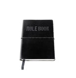 Rule book. A black leather bound rule book, isolated against white Royalty Free Stock Photos