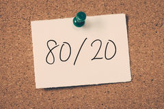 80/20. 80 20 rule concept reminder message on a cork board Stock Images