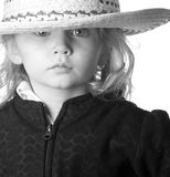 The rule of thirds. A cute but serious cowgirl is photographed using the rule of thirds royalty free stock photography