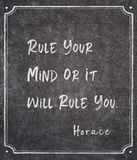Rule you Horace quote. Rule your mind or it will rule you - ancient Roman philosopher Horace quote written on framed chalkboard royalty free stock photos