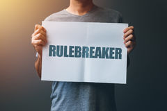 Rulebreaker attitude, person who breakes the rules Royalty Free Stock Image