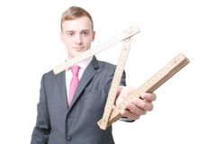 Ruler. A business man with a folding ruler royalty free stock image