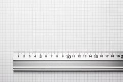 Ruler aligned to a scaled paper Royalty Free Stock Photography