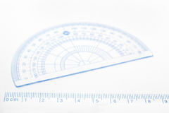 Ruler and blurred protractor Stock Images